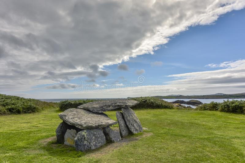 Altar Wedge Tomb - wedge-shaped gallery grave and National Monument of late Neolithic and early Broze Age, Tormore Bay, County Cor royalty free stock image