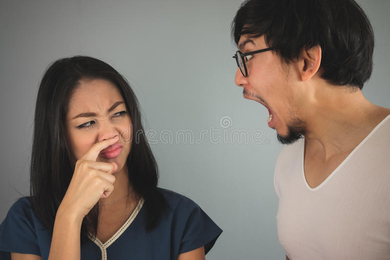 Bad breath from husband. stock photos