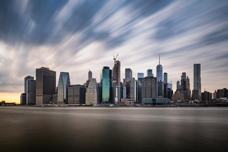 Dark clouds comming quickly over the New York Lower Manhattan during cloudy day stock photography