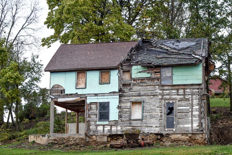 Destroyed, Weathered, Dilapidated House in Need of Repair stock photo