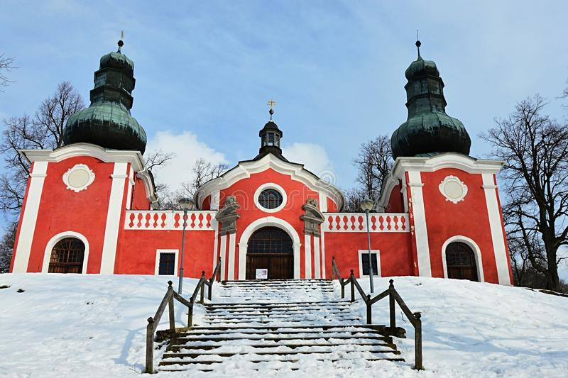 Lower baroque church on calvary in Banska Stiavnica with snow covered staircase. Photograph taken during partly cloudy winter day stock images