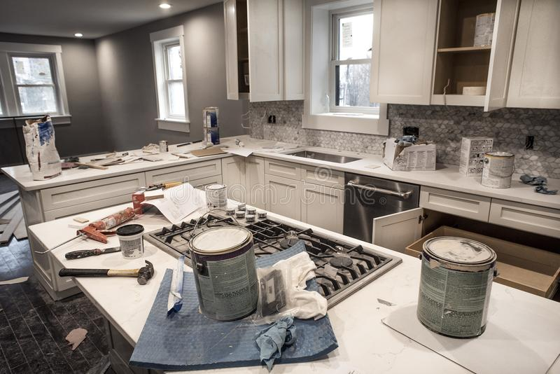 Messy home kitchen during remodeling fixer upper with kitchen cabinet doors royalty free stock photo