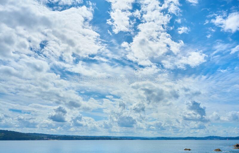 Nice photograph of the sky with clouds and the sea on the lower horizon stock photography