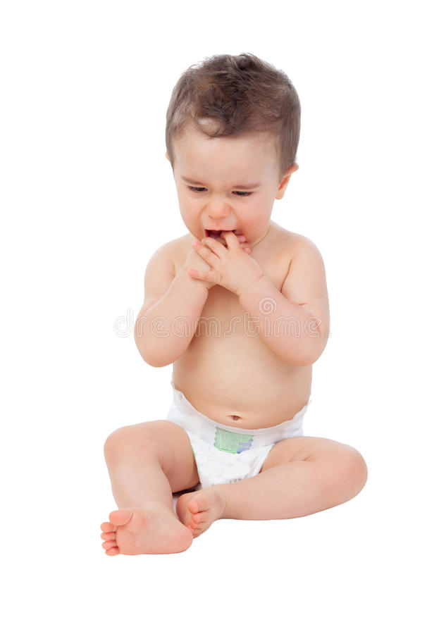 Sad baby with sore gums crying. Isolated on a white background stock photos
