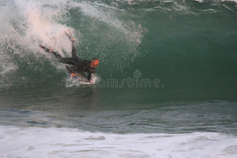 Surfing The Wedge stock photos