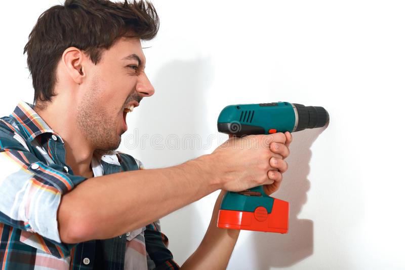 Young man doing repair royalty free stock photography