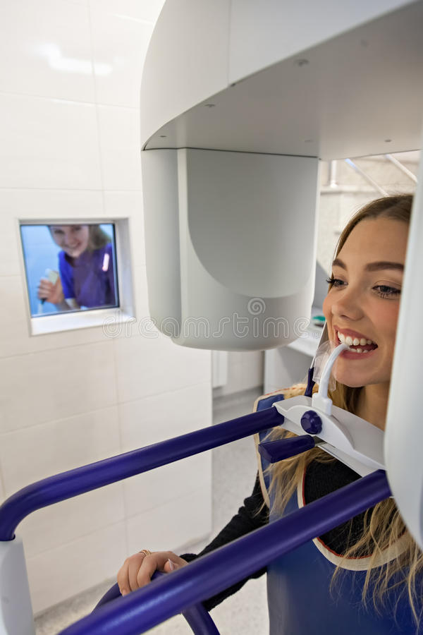 Young Woman Having Panoramic Digital X-ray Of Her Teeth royalty free stock photography