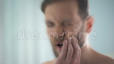Sharp toothache disturbing man, dental caries, gingivitis, blurred effect. Stock footage stock video