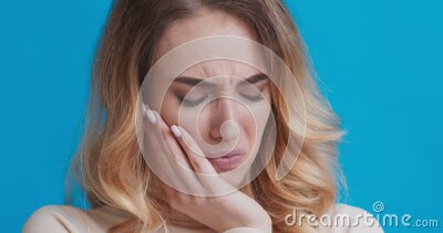 Woman suffering from strong tooth pain, close up. Teeth problem. Woman suffering from strong tooth pain, close up portrait stock video footage