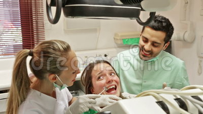 Young girl treats teeth. In the dental clinic stock video